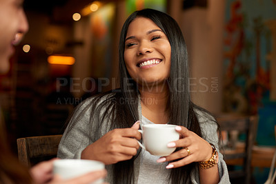 Buy stock photo Cropped shot of an attractive young woman smiling while having coffee with her friend in a cafe