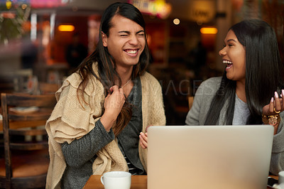 Buy stock photo Cropped shot of young people using a laptop in a coffee shop
