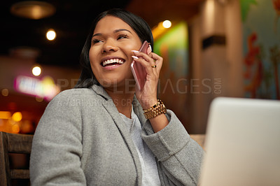 Buy stock photo Cropped shot of an attractive young woman taking a phonecall while using a laptop in a cafe
