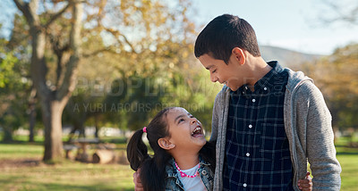 Buy stock photo Shot of an adorable brother and sister having a fun day at the park