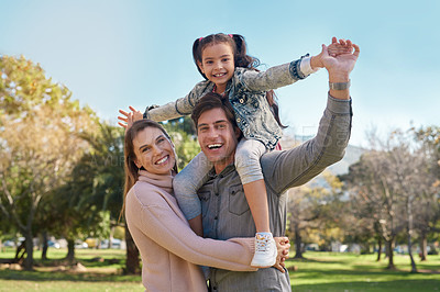 Buy stock photo Shot of an adorable little girl having fun with her parents at the park