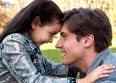Buy stock photo Shot of an adorable little girl spending quality time with her father at the park