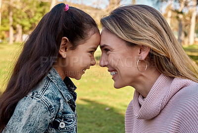 Buy stock photo Shot of an adorable little girl spending quality time with her mother at the park