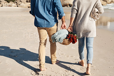 Buy stock photo Cropped shot of an unrecognizable couple walking together on the beach