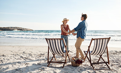 Buy stock photo Shot of a middle aged couple dancing on the beach