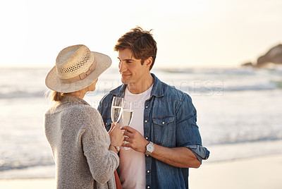 Buy stock photo Shot of a middle aged couple having champagne while spending the day outdoors