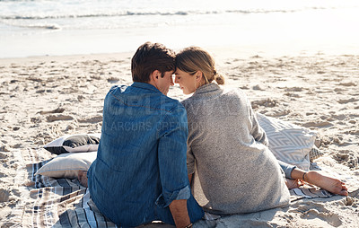 Buy stock photo Rearview shot of a middle aged couple sitting on the beach