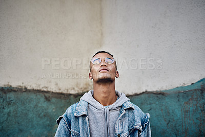 Buy stock photo Cropped shot of a handsome young man out in the city