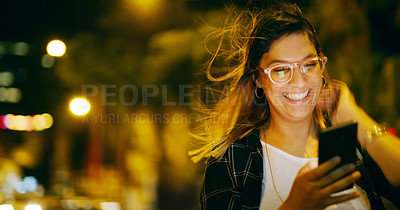 Buy stock photo Cropped shot of an attractive young businesswoman standing outside alone and texting on her cellphone late at night