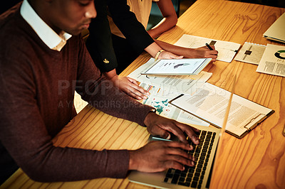 Buy stock photo Cropped shot of a diverse group of businesspeople sitting in the office and working with technology and paperwork at night