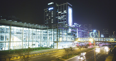 Buy stock photo Cropped shot of a brightly lit central business district during the late hours of the night