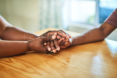 Buy stock photo Cropped shot of two unrecognizable people holding hands at