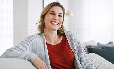 Buy stock photo Cropped shot of a middle aged woman relaxing at home