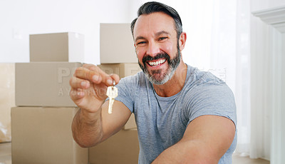 Buy stock photo Shot of a middle aged man holding the key to his new home