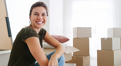 Buy stock photo Shot of a middle aged woman moving into her new home