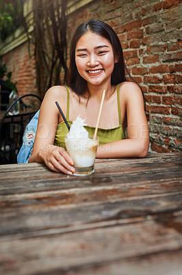 Buy stock photo Portrait of an attractive young woman having drinks and enjoying herself at an outdoor cafe