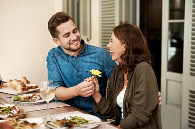 Buy stock photo Cropped shot of a couple enjoying a meal together in the yard at home