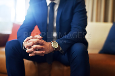 Buy stock photo Shot of an unrecognizable and stylish man sitting on a couch indoors