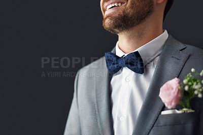 Buy stock photo Shot of an unrecognizable bridegroom smiling and feeling cheerful on his wedding day
