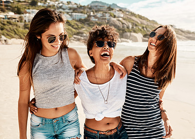 Buy stock photo Shot of a group of happy young women enjoying a summer's day at the beach