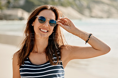 Buy stock photo Portrait of a happy young woman enjoying a summer's day at the beach