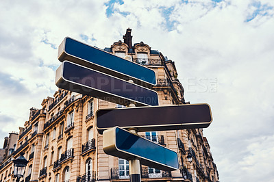 Buy stock photo Shot of directional road signs in the city of Paris