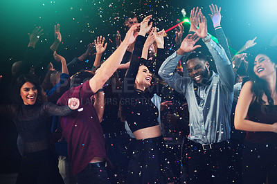 Buy stock photo Cropped shot of a diverse group off young friends dancing at a party at night