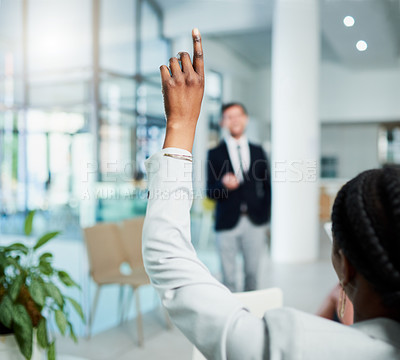Buy stock photo Rearview shot of an unrecognizable businesswoman raising her hand to ask a question at a business conference