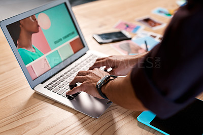 Buy stock photo Cropped shot of an unrecognizable businessman standing alone in his office and typing on his laptop