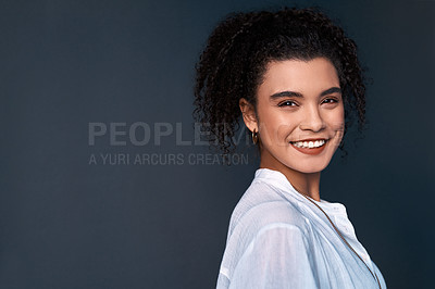 Buy stock photo Cropped portrait of an attractive young businesswoman standing against a gray background alone in the studio