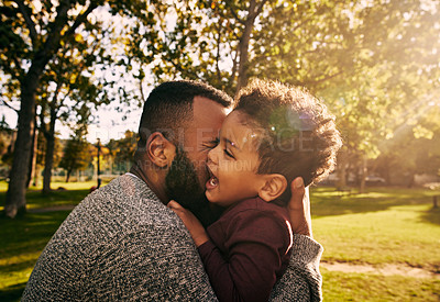 Buy stock photo Shot of a father bonding with his little son at the park