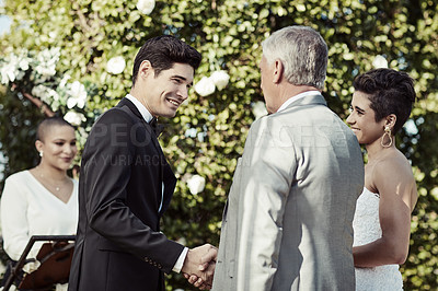 Buy stock photo Shot of a mature man shaking his daughter's soon to be husband's hand on their wedding day