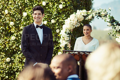 Buy stock photo Shot of a young man waiting for his bride at the altar on their wedding day