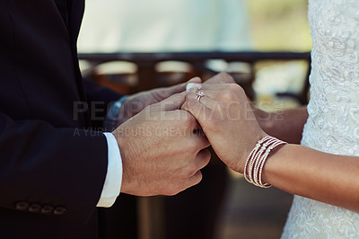 Buy stock photo Cropped shot of a couple holding hands on their wedding day
