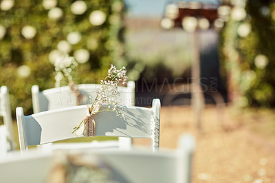 Buy stock photo Shot of chairs at an empty wedding venue set in a garden