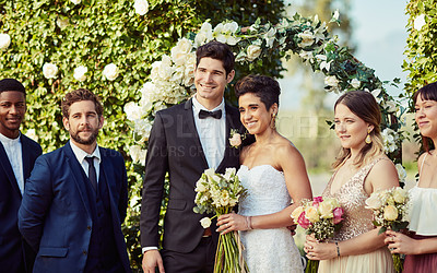 Buy stock photo Portrait of a happy young couple standing with their bridesmaids and groomsmen on their wedding day