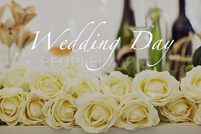 """Buy stock photo Shot of white roses on a table at a wedding reception with the words """"Wedding Day"""" across it"""