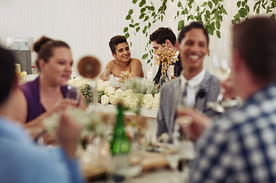 Buy stock photo Shot of a happy young couple at their wedding reception