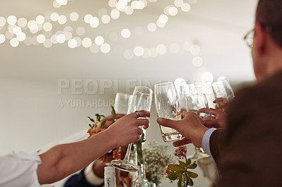 Buy stock photo Cropped shot of a group of wedding guests toasting with wine at a wedding reception