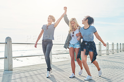 Buy stock photo Shot of three friends spending the day together on a sunny day