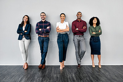 Buy stock photo Studio shot of a group of businesspeople standing in line against a grey background