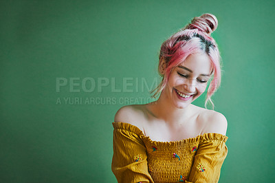 Buy stock photo Shot of an attractive young woman posing against a green background