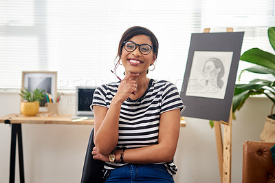 Buy stock photo Portrait of an attractive and artistic young woman holding a paintbrush while working in her studio at home