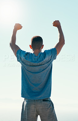 Buy stock photo Rearview shot of a young man celebrating his victory after a run outdoors