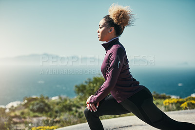 Buy stock photo Cropped shot of a young woman stretching outdoors before her run