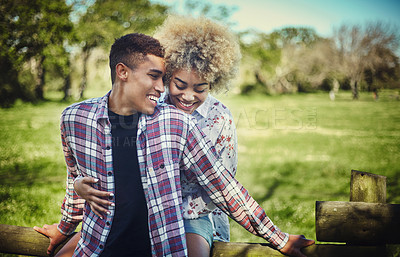 Buy stock photo Shot of a young couple spending quality time together at the park