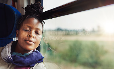 Buy stock photo Cropped shot of an attractive young woman sitting alone and closing her eyes to rest while on a train