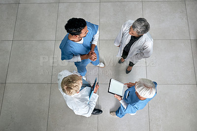 Buy stock photo High angle shot of a group of medical practitioners having a discussion in a hospital