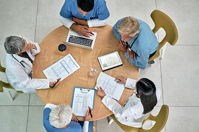 Buy stock photo High angle shot of a group of medical practitioners having a meeting in a hospital