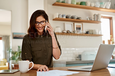 Buy stock photo Cropped shot of an attractive young woman smiling while taking a phonecall while working from home